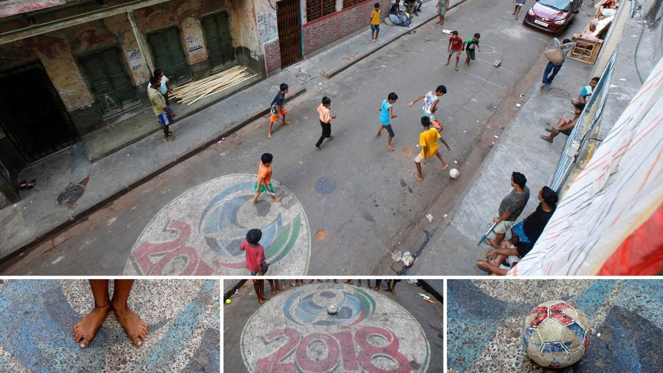 On a dusty Kolkata street, painted with a 2018 World Cup logo children brave traffic for a barefoot game. One of them is a fan of Argentinean forward Lionel Messi, another worships Portuguese striker Cristiano Ronaldo. Both Messi and Ronaldo are contemporary legends but still haven't quite proved themselves on the grandest stage yet. Will one come out better this time? Time will tell. (Rupak De Chowdhuri / REUTERS)