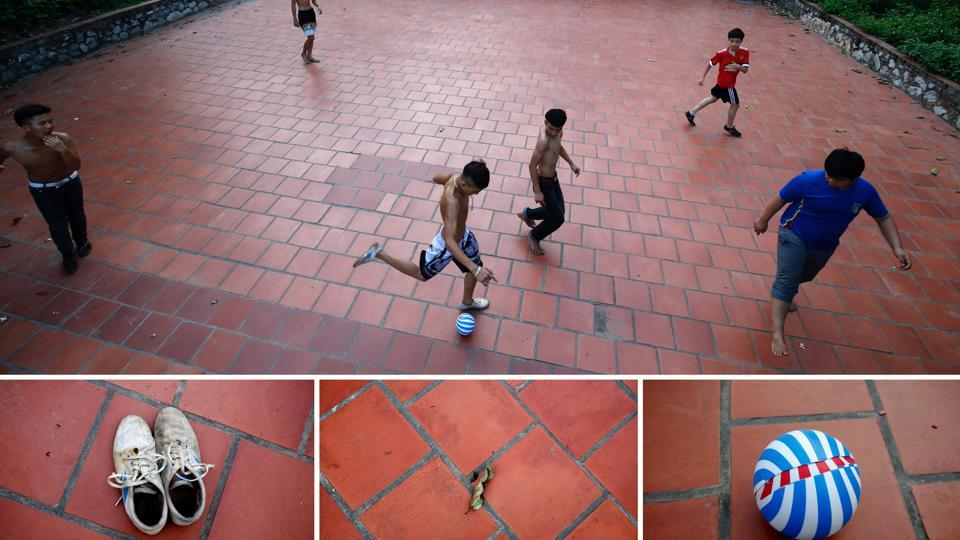An outlined brick court in front of a temple in Hoang Xa village, outside Hanoi, Vietnam works just as well. No jerseys? It's shirts versus skins in that case. (Kham / REUTERS)