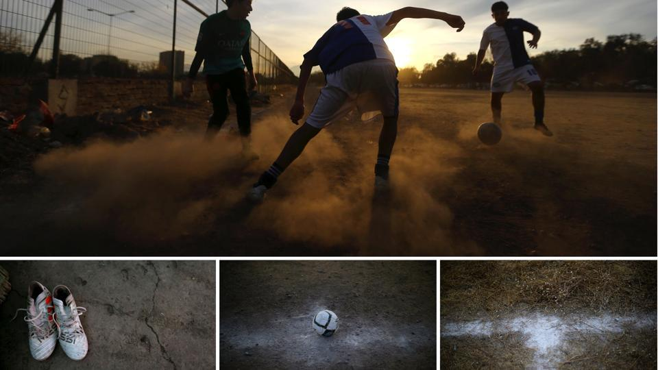 A player dribbles with the ball as another looks to defend during a match in Santiago, Chile. In its formalised and codified form, Britain is the cradle of modern football. The sportization of the game in schools and the impact of colonisation took it to Asia and Middle East and South America. (Ivan Alvarado / REUTERS)
