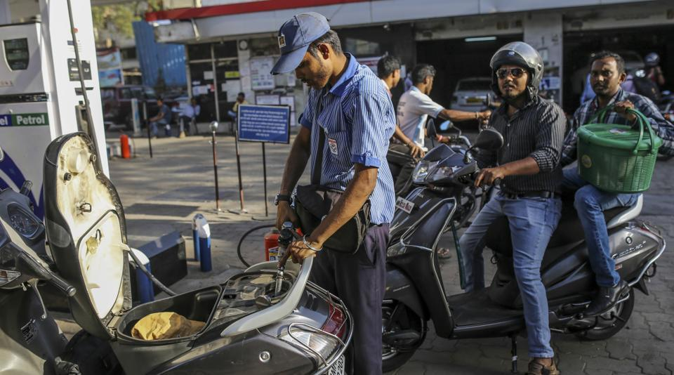 A worker refuels a motorcycle at a Hindustan Petroleum Corp. gas station in Mumbai, India.