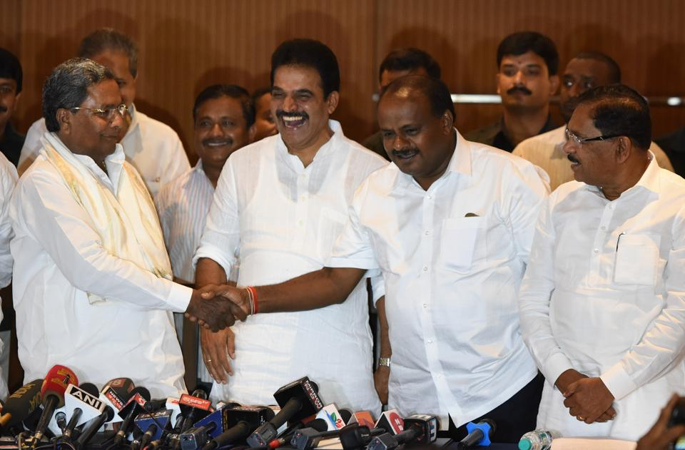 Congress leader KC Venugopal shares a light moment with Siddaramaiah in the presence of Dy. Chief Minister Parmeshwara and Chief Minister of Karnataka Kumarswamy after a joint press conference to announce the distribution of portfolio sharing in Karnataka at a city hotel in Bengaluru.