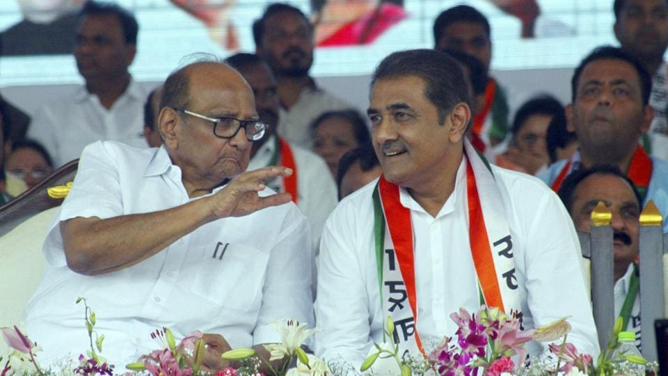 Nationalist Sharad Pawar(left)  along with party leader Praful Patel at the party's at a rally to mark the party's 19th anniversary in Pune on Sunday.