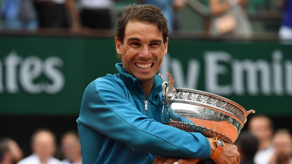 Spain's Rafael Nadal poses with the Mousquetaires Cup (The Musketeers) after his victory in the men's singles final match against Austria's Dominic Thiem, Paris, June 10, 2018