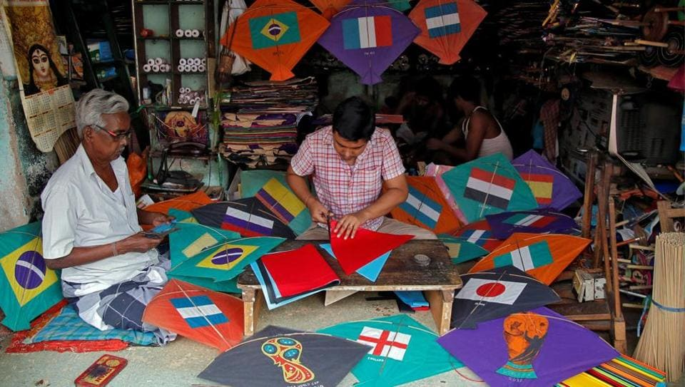 Kite-makers make kites with pictures of the national flags of the countries participating in the upcoming FIFA World Cup in Russia, at a workshop in Kolkata, India.  (REUTERS)