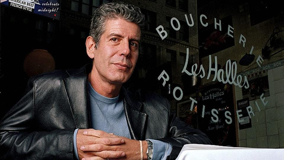 This December 19, 2001 file photo shows Anthony Bourdain, the owner and chef of Les Halles restaurant, sitting at one of the tables in New York.