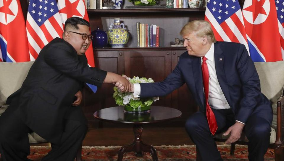 US President Donald Trump shakes hands with North Korea leader Kim Jong Un during their first meetings at the Capella resort on Sentosa Island Tuesday, June 12, 2018 in Singapore.