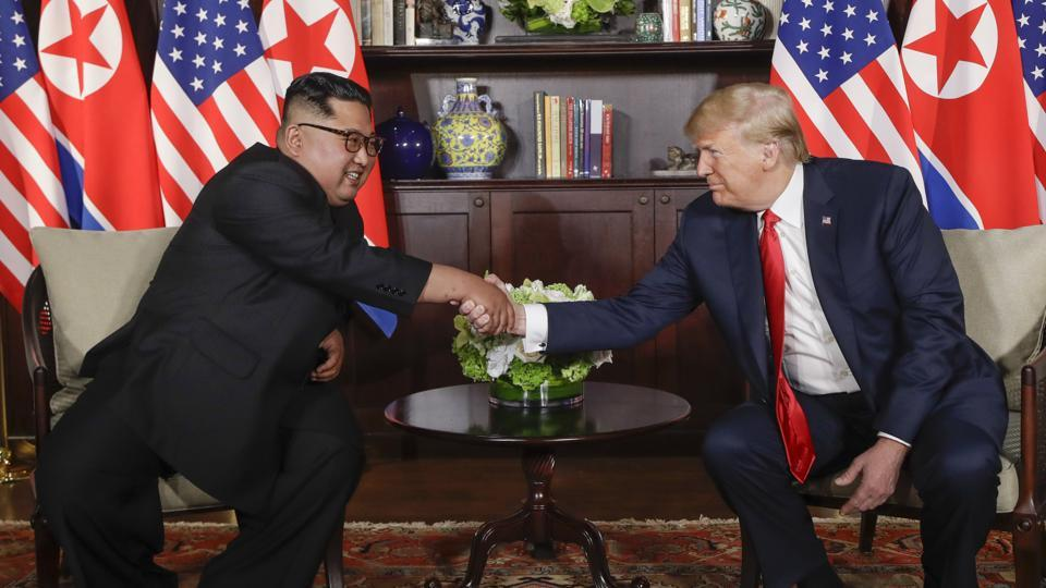 Donald Trump and Kim Jong Un shared warm words and a historic handshake Tuesday as they held an unprecedented summit to confront a decades-old nuclear stand-off and enmity stretching back to the Cold War. It is the first-ever meeting between sitting leaders of the two nuclear-armed nations and was unthinkable just months ago, when fears of war mounted amid missile tests and verbal insults between the two leaders. (Evan Vucci / AP)