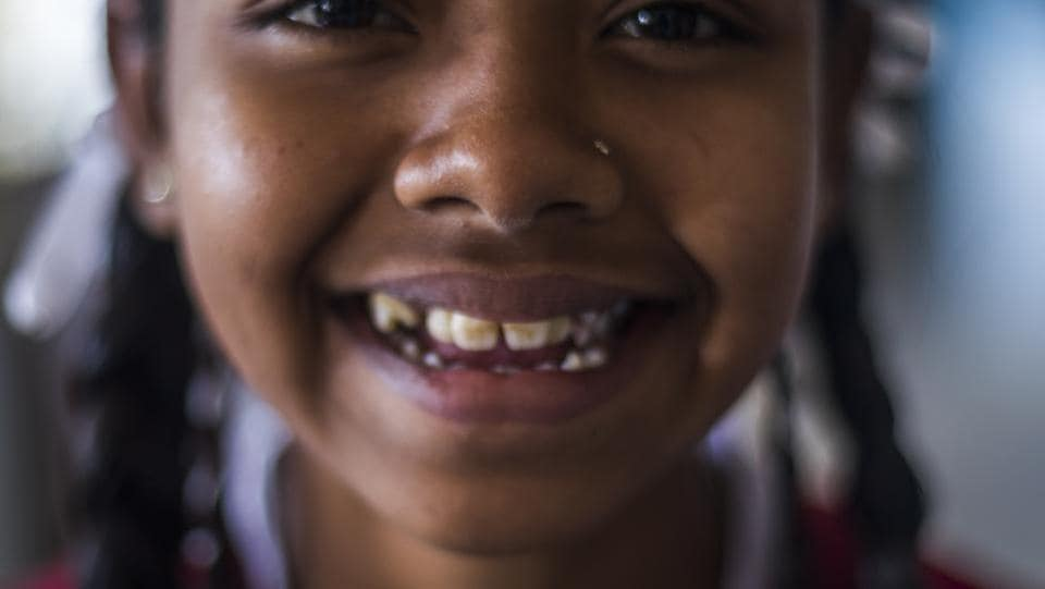 This Class VI student ails from dental fluorosis from contaminated water at home and school. High fluoride levels are becoming a critical health hazard in Kanker, a district in the southern most region of Chhattisgarh. As per National Rural Drinking Water Programme, around 400 habitations or 1.25 lakh people are affected by fluoride contamination in rural Chhattisgarh. (Prashanth Vishwanathan / WaterAid)