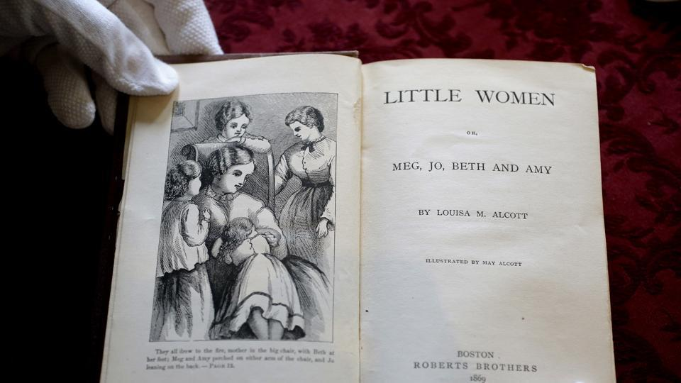 The title page of the book Little Women by Louisa May Alcott seen in an 1869 edition of the book at Orchard House in Concord, Massachusetts. A century and a half before the #MeToo movement gave women a bold, new collective voice, Alcott was lending them her own. To celebrate the sesquicentennial, Orchard House has lined events, including a conversational series to discuss the book's modern-day relevance. (Steven Senne / AP)