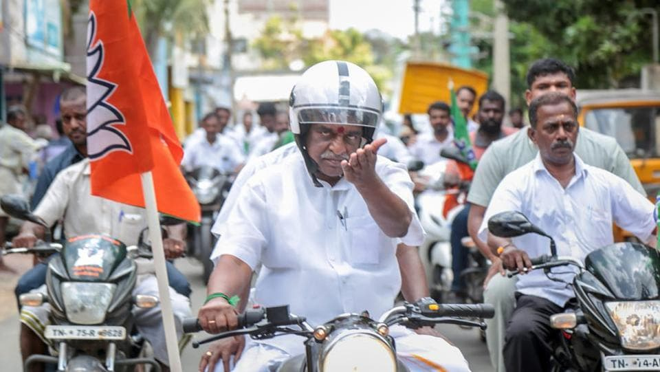 Union minister and BJP leader Pon Radhakrishnan leads a bike rally to celebrate 4 years of the party's government at the Centre in Nagercoil, Tamil Nadu on Tuesday. (PTI)
