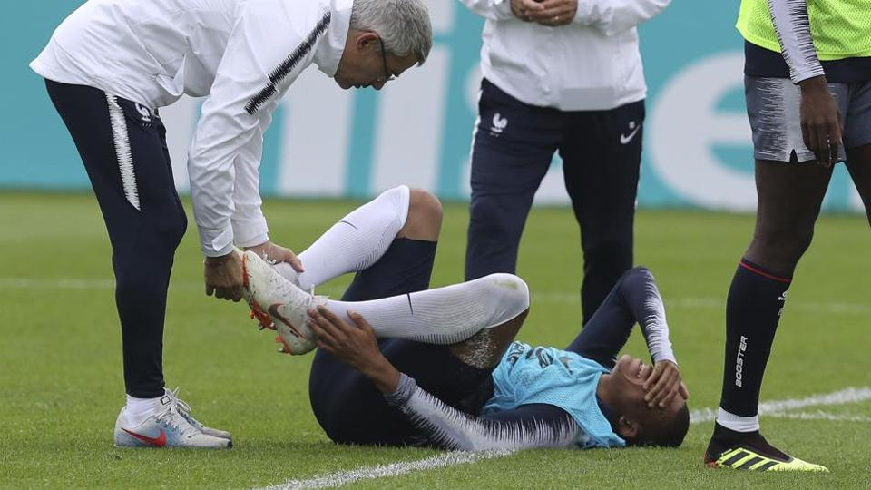 France's Kylian Mbappe grimaces after being injured during a training session ahead of the FIFA World Cup 2018.