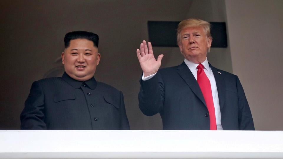 US President Donald Trump waves next to North Korean leader Kim Jong Un at the Capella Hotel on Sentosa island in Singapore June 12, 2018.