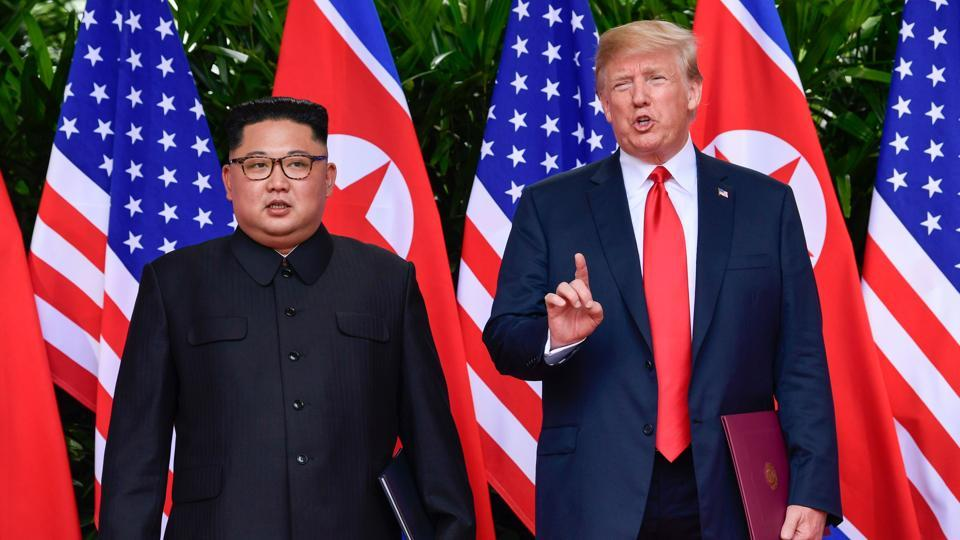 US President Donald Trump makes a statement before saying goodbye to North Korea leader Kim Jong Un (L) after their meetings at the Capella resort on Sentosa Island in Singapore on June 12, 2018.