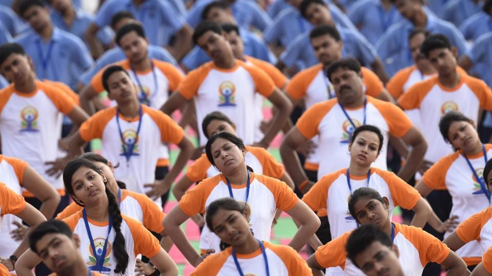 Participants perform yoga on International Yoga Day 2017 in Lucknow.