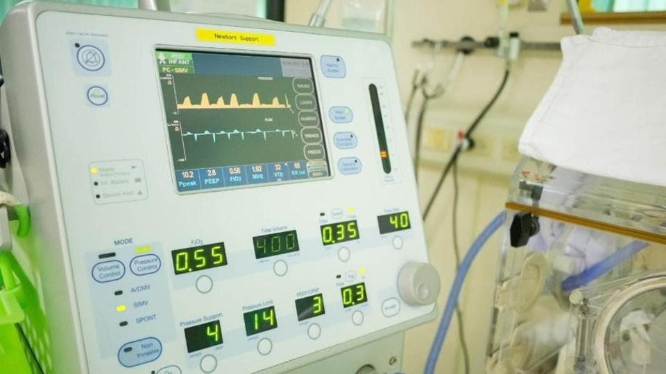 A ventilator aids movement of air into and out of the lungs to provide breathing to a critically ill patient.