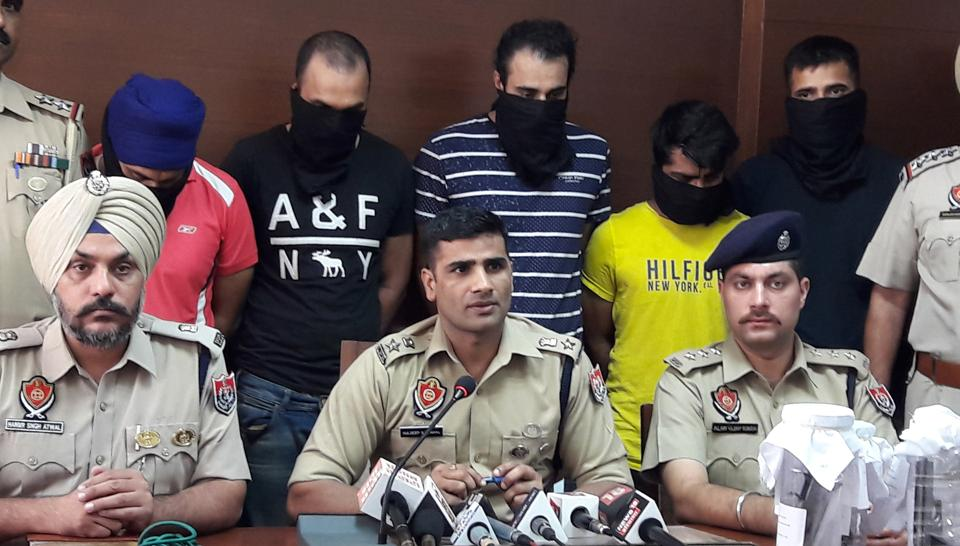Mohali SSP Kuldeep Singh Chahal producing the five gangsters before mediapersons in Mohali.