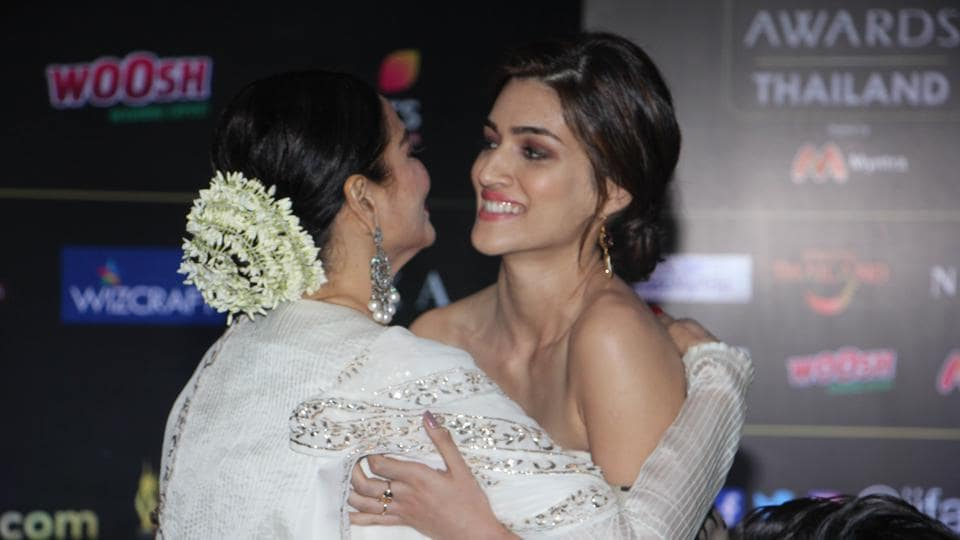 Rekha and Kriti Sanon greet each other at IIFA press conference in Mumbai on Tuesday.