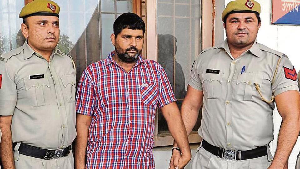 Accused Rakesh Mokhriya in police custody in Rohtak on Tuesday.