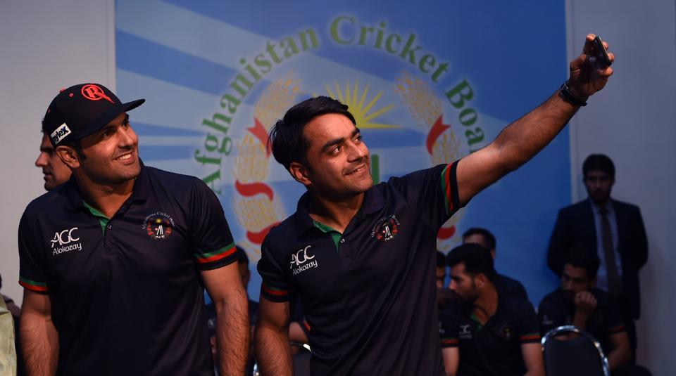 Afghan spinners Rashid Khan (R), Mohammed Nabi (L) and Mujeeb ur Rahman (not pictured) will no doubt be challenged by the transition from bowling with a white ball to the red ball.