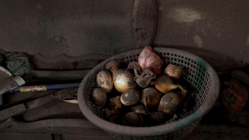 Onions sit drying at a house affected by the eruption at San Miguel Los Lotes in Escuintla. Guatemalan authorities reacted slowly to signs of Fuego's impending eruption on June 3, contributing to one of the most tragic natural disasters in recent Guatemalan history. (Carlos Jasso / REUTERS)