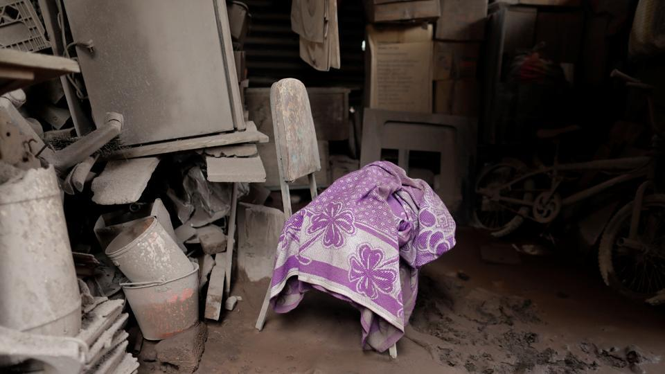 A blanket lies on a chair inside a house at San Miguel Los Lotes. Many lost 10 to 50 relatives each, descendants of intertwining generations of small families who settled in Los Lotes more than 40 years ago. They refuse to give up hope of finding relatives --or at least their remains. (Carlos Jasso / REUTERS)