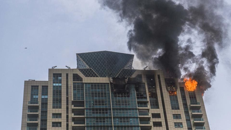 A fire broke out in a high-rise building in south Mumbai on Wednesday afternoon. No casualties are reported. Around 90 residents were evacuated from the building in which Bollywood actor Deepika Padukone reportedly owns an apartment. This is the third major fire to have broken out in Mumbai in the past week. (Pratik Chorge / HT Photo)