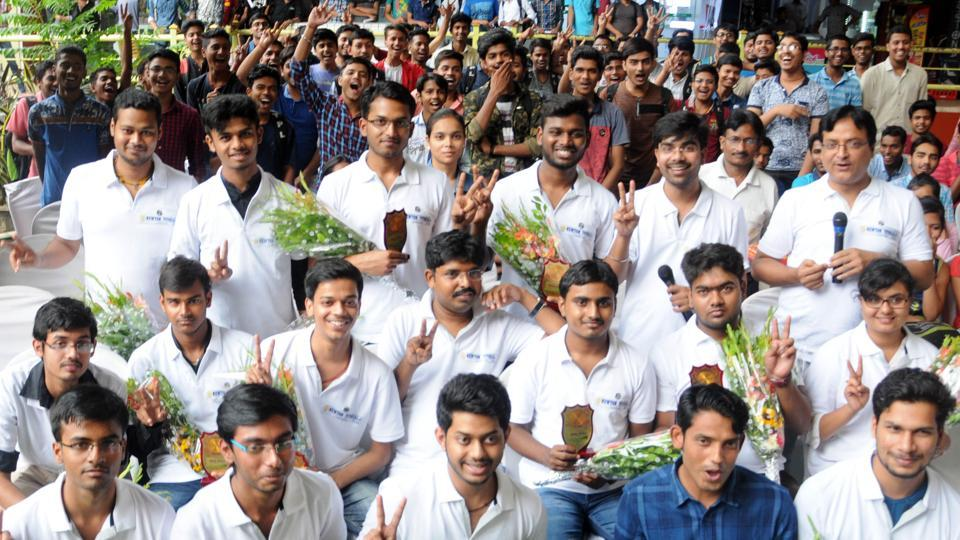 Students who were selected in IIT JEE Advance 2018 test celebrate their result outside a coaching institute in Ranchi.