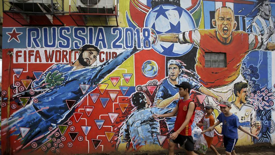 A mural of footballers in action to advertise the upcoming the FIFA World Cup 2018 on the outskirts of Jakarta, Indonesia. (AP)