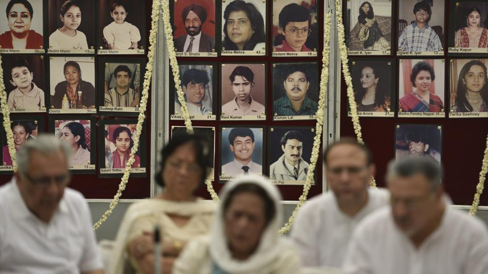 Family members of the Uphaar fire tragedy victims grieve on its 21st Anniversary at Green Park in New Delhi. It was on June 13, 1997, that Bollywood blockbuster 'Border' was screening at Uphaar Cinema in south Delhi's Green Park when a fire broke out halfway through the movie. The incident claimed the lives of 59 people and over 100 were injured due to suffocation in the ensuing stampede. (Sanchit Khanna / HT Photo)