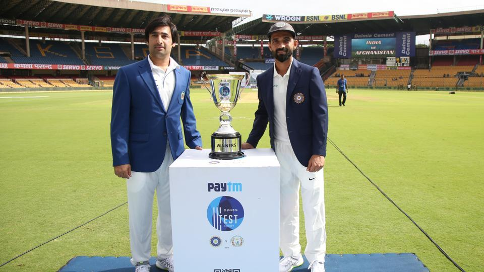 Both captains pose with the trophy as Afghanistan entered the elite club of nations to play Test cricket. (BCCI)