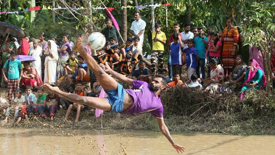 Indian footballer C K Vineeth in action during an exhibition match in the monsoon-drenched paddy fields of north Kerala. The FIFA World Cup 2018 kicks off in Russia today, but visitors to Kerala these past days may well have mistaken the southern state as this year's host with the sort of football frenzy on display. (K Sasi / HT Photo)