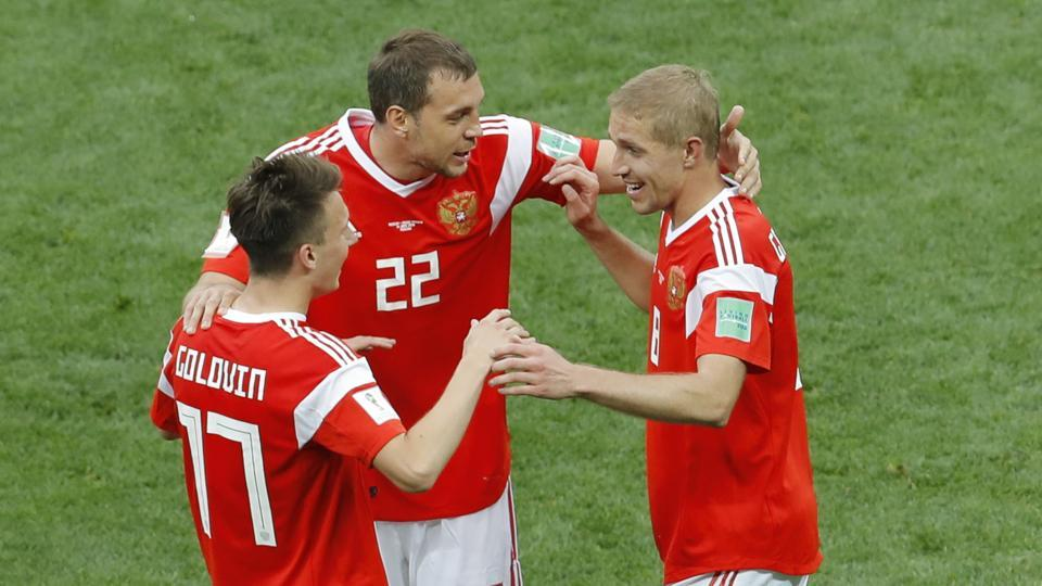 Russia's Alexander Golovin, left, is greeted by teammates Yuri Gazinsky, right, and Artyom Dzyuba the after scoring his side fifth goal agains Saudi Arabia during their group A match which opened the 2018 soccer World Cup at the Luzhniki stadium in Moscow. Get full score and updates of the FIFA World Cup 2018 opening match between Russia and Saudi Arabia here.