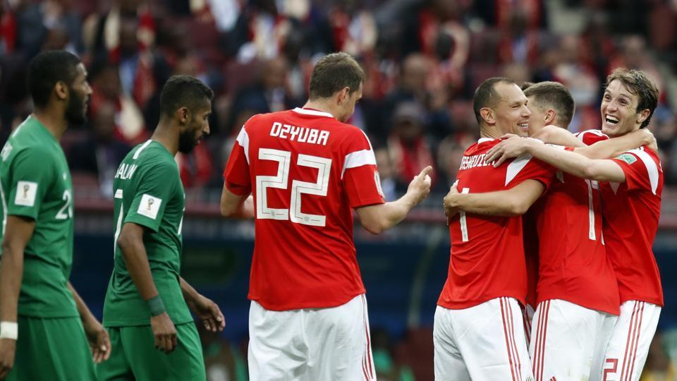 Goals from Yury Gazinsky, Denis Cheryshev (2), Artem Dzyuba and Aleksandr Golovin gave Russia a commanding 5-0 win over Saudi Arabia. (AP)
