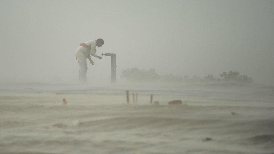 A devotee drinks from a tap during a dust storm at the Sangam, the confluence of the rivers Ganga, Yamuna and Saraswati in Allahabad. Dust storms hit various parts of Uttar Pradesh, leaving seven persons dead and 21 injured, an official spokesman said. Taking note, chief minister Yogi Adityanath has ordered district magistrates concerned to ensure proper treatment for the injured. (Sanjay Kanojia / AFP File)