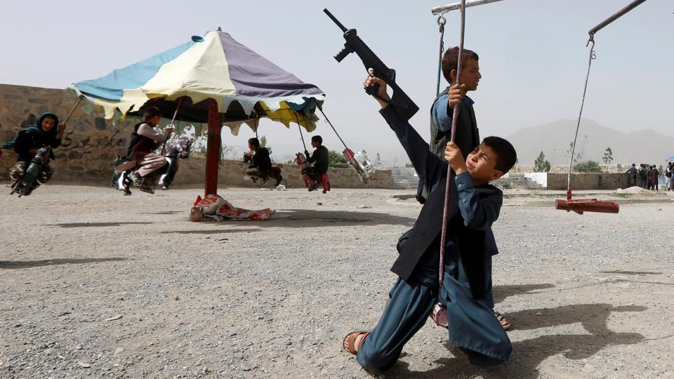 Afghan children ride swings during the first day of the holiday of Eid al-Fitr, which marks the end of the holy month of Ramadan, in Kabul, Afghanistan. (Omar Sobhani / REUTERS)