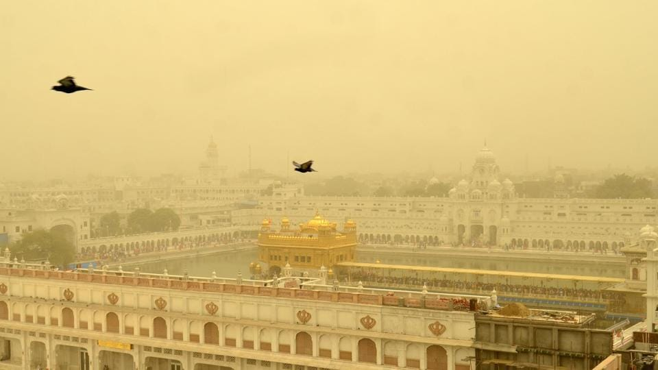 A view of the Golden Temple engulfed in haze due to sudden change in weather, in Amritsar on Friday. (Sameer Sehgal/HT)