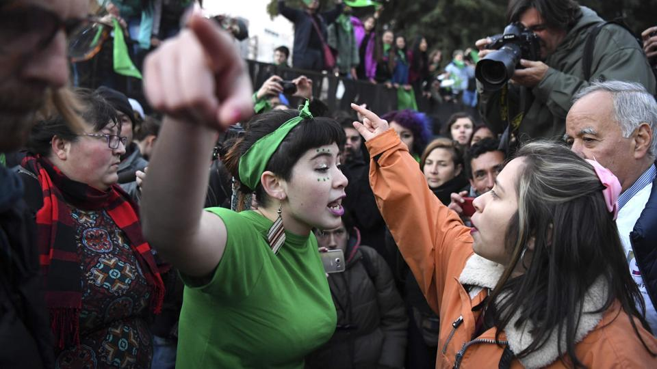 A pro-choice activist (L) argues with a woman opposed to the legalization of abortion outside the Argentine Congress in Buenos Aires, Argentina. (Eitan Abramovich / AFP)