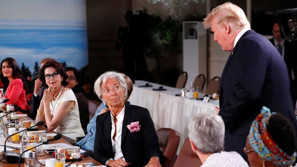US President Donald Trump arrives late, as Managing Director of the International Monetary Fund Christine Lagarde looks up during a G7 and Gender Equality Advisory Council meeting as part of a G7 summit in the Charlevoix city of La Malbaie, Canada. (Yves Herman / REUTERS)