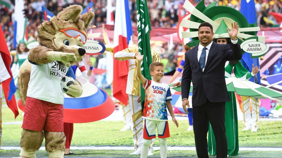 Brazilian football legend Ronaldo (R) waves beside the Russia 2018 World Cup mascot Zabivaka during the opening ceremony. Football legend Pele was expected to be a part of the celebrations but had to give them a miss due to health reasons. (Patrik Stollarz / AFP)
