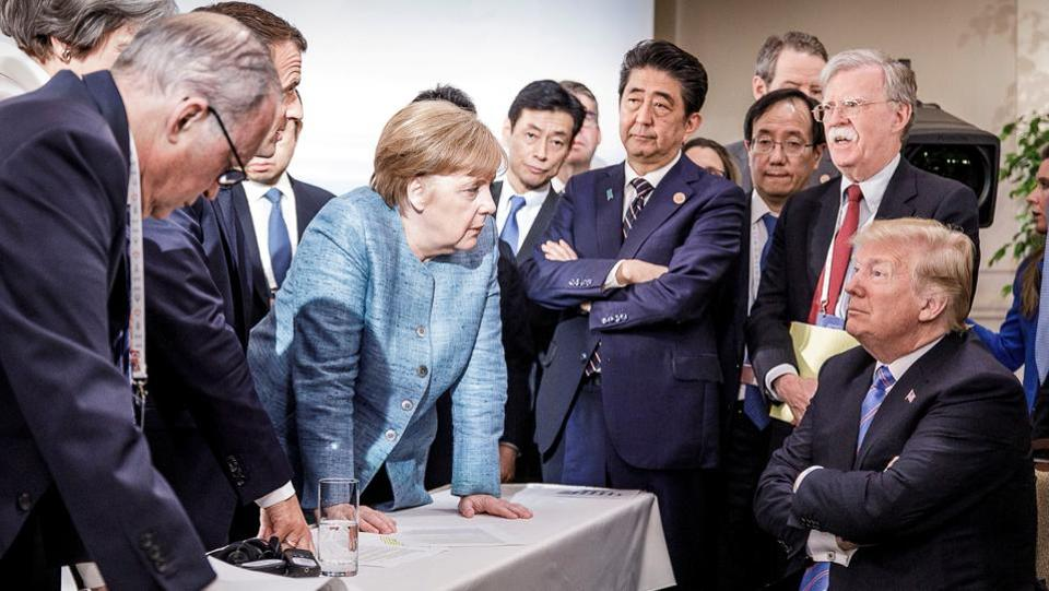 German Chancellor Angela Merkel speaks to US President Donald Trump during the second day of the G7 meeting in Charlevoix city of La Malbaie, Quebec, Canada. (Bundesregierung / Jesco Denzel / Handout via REUTERS)