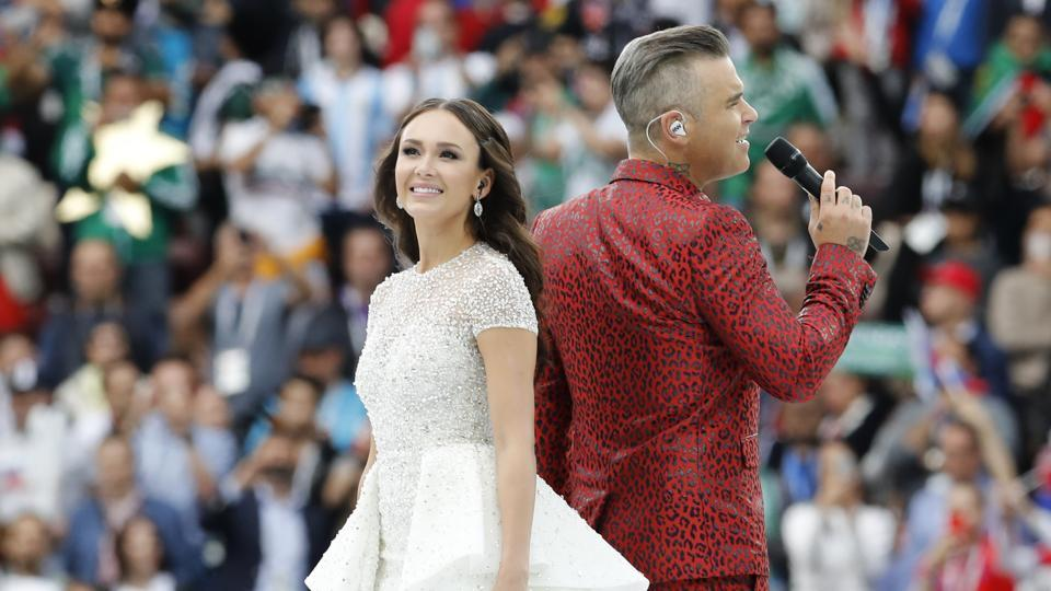 "Robbie Williams sings was joined by Russian soprano Aida Garifullina ahead of the start of the group A match between Russia and Saudi Arabia. Williams said he was fulfilling ""a boyhood dream"" performing at the World Cup, if only as a singer and not with the ball. The singer belted out hits to a cheering crowd. (Antonio Calanni / AP)"