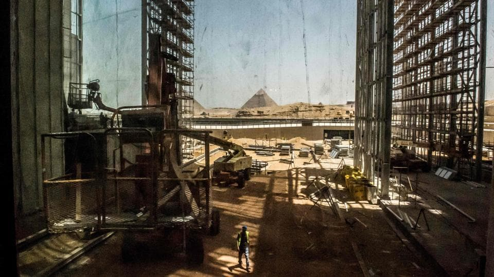 A view of construction work undergoing at the site of the Grand Egyptian Museum in Giza on the southwestern outskirts of the capital Cairo, with the Pyramid of Khafre (Chephren) seen in the background. (Khaled Desouki / AFP)
