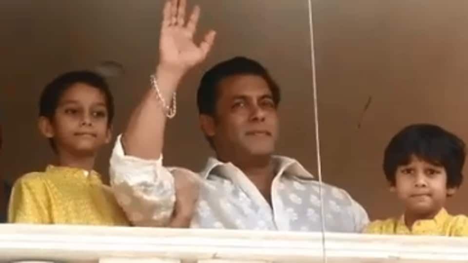 Salman Khan waves to his fans from his apartment.