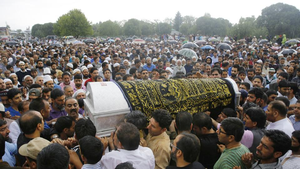 People carry the coffin of slain editor-in-chief of the Srinagar-based newspaper, Rising Kashmir, Shujaat Bukhari, during a funeral procession at Kreeri, some 40 kms north of Srinagar