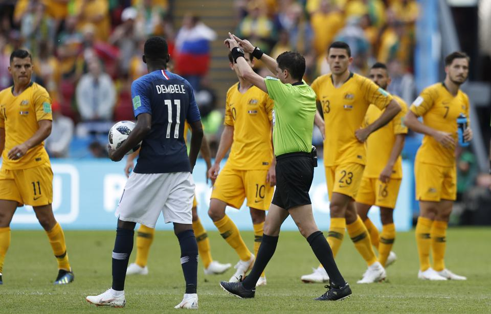Referee Andres Cunha from Uruguay, centre, gestures for a penalty fro France after consulting VAR, from which France's Antoine Griezmann scored, during the group C match between France and Australia at the 2018 soccer World Cup in the Kazan Arena in Kazan. (AP)