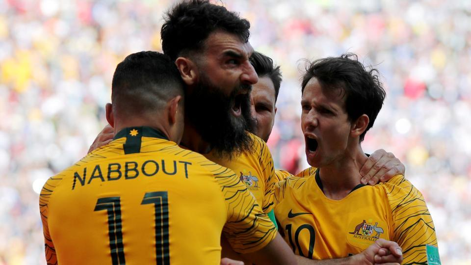 Australia's Mile Jedinak celebrates scoring their first goal with team mates. (REUTERS)