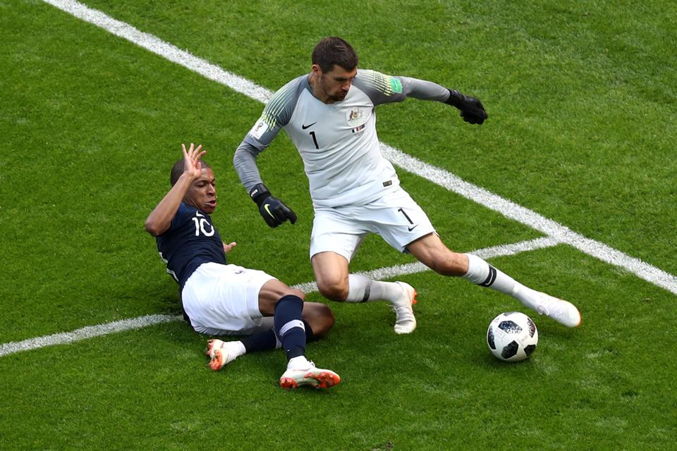 Australia's Mathew Ryan in action with France's Kylian Mbappe. (REUTERS)