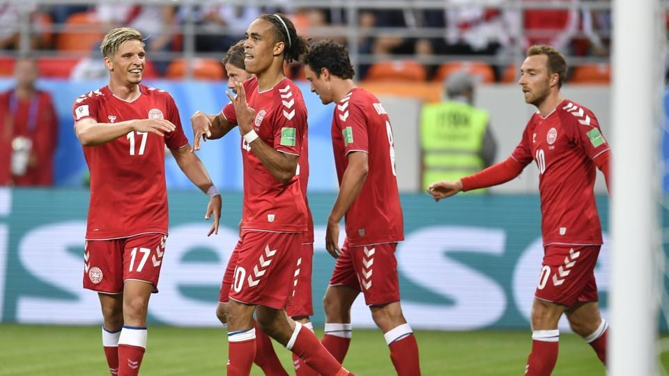 Denmark's Yussuf Yurary Poulsen (C) celebrates with his teammates after scoring during the group C match between Peru and Denmark at the FIFAWorld Cup 2018 in the Mordovia Arena in Saransk, Russia on June 16, 2018.