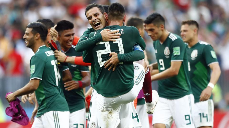 Mexico players celebrate after winning the group F match against Germany. (AP)