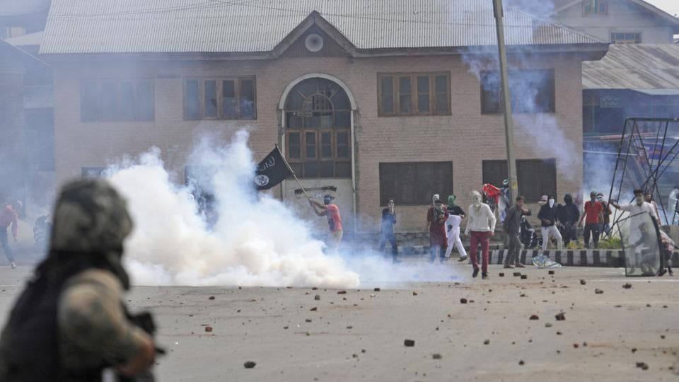 Protesters clash with security personnel in Srinagar on Saturday.